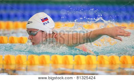 GRAZ, AUSTRIA - APRIL 05, 2014: Katarina Listopadova (Slovakia) places 3rd in the women's 200m butterfly event in an indoor swimming meeting.