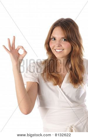 Beautiful young girl indicating ok sign
