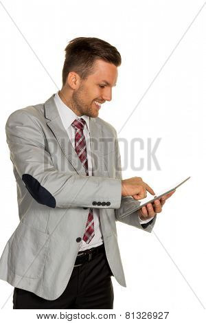a manager or entrepreneur holding a tablet computer in hand