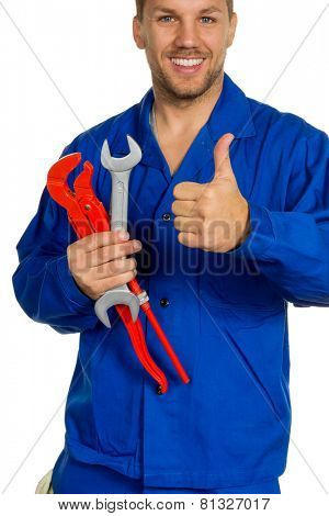 a worker in an industrial enterprise craftsmen with tools in hand