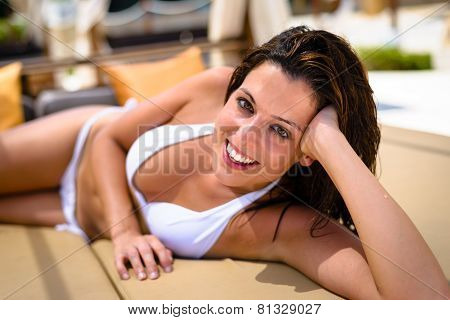 Woman Relaxing On Summer Vacation In Chaise-longue