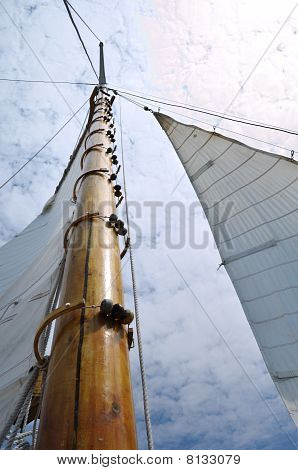Jib And Wooden Mast Of Schooner Sailboat
