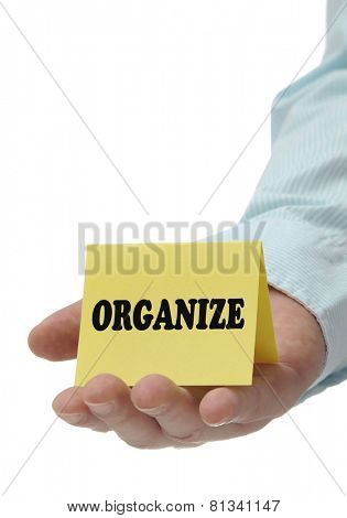 Business man holding organize sign on hand