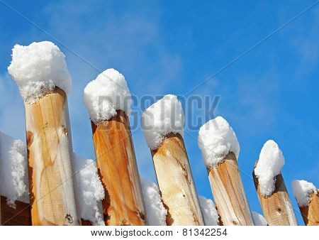 Wooden Fence With Snow Caps