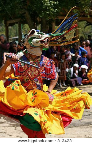 A dancer with colorful mask