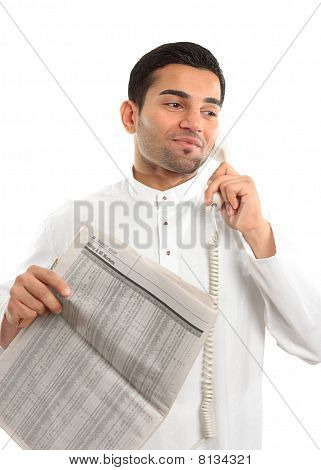 Stockbroker Or Businessman On Phone Holding Newspaper