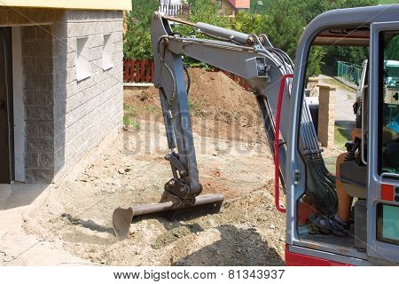 a small excavator provides garden at the house