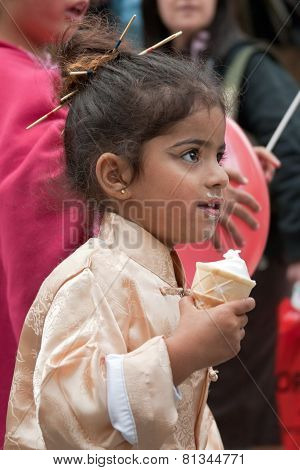 Jerusalem, Israel - March 15, 2006: Purim Carnival. A Little Girl Dressed In A Suit Japanese