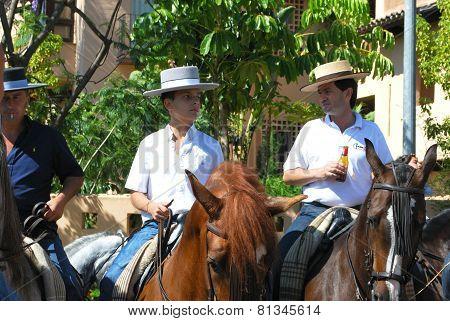 Spanish men on horses.