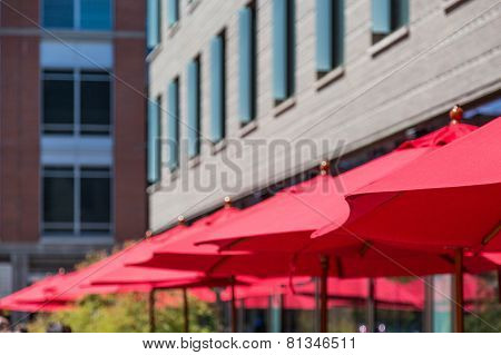 Red Umbrellas By Building
