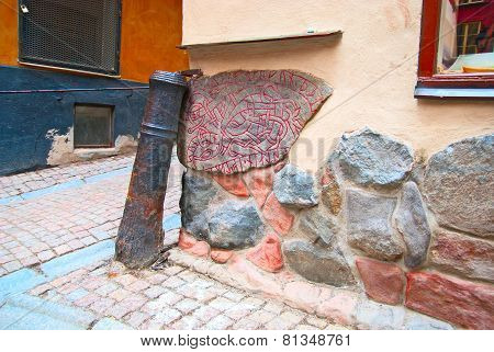 Sweden. Stockholm. Ancient runestone built into a wall in Gamla Stan (Old Town)