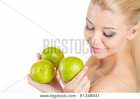 Portrait of a blue-eyed blonde with green Apple.