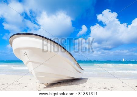 White Pleasure Motor Boat Lays On Sandy Beach