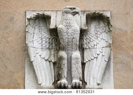 BERLIN, GERMANY - JANUARY 6, 2015: German Eagle from the 1930s on the main building of the Tempelhof Airport in Berlin, Germany.