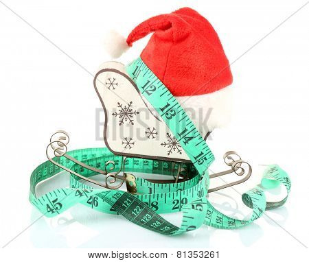 Measuring tape with Christmas decoration isolated on white