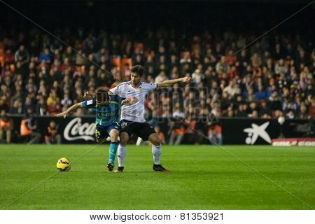 VALENCIA, SPAIN - JANUARY 25: Coke (L) and Andre Gomes (R) during Spanish League match between Valencia CF and Sevilla FC at Mestalla Stadium on January 25, 2015 in Valencia, Spain