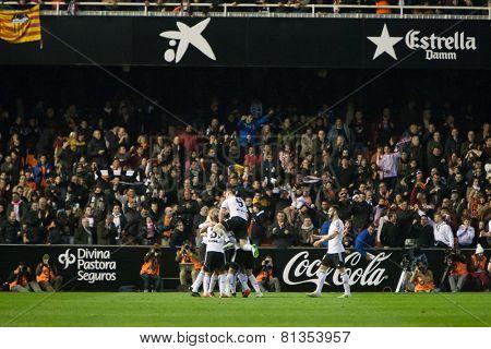 VALENCIA, SPAIN - JANUARY 25: Valencia players celebrating a goal during Spanish League match between Valencia CF and Sevilla FC at Mestalla Stadium on January 25, 2015 in Valencia, Spain