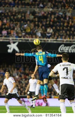 VALENCIA, SPAIN - JANUARY 25: Krychowiak (F) jumping for the ball during Spanish League match between Valencia CF and Sevilla FC at Mestalla Stadium on January 25, 2015 in Valencia, Spain