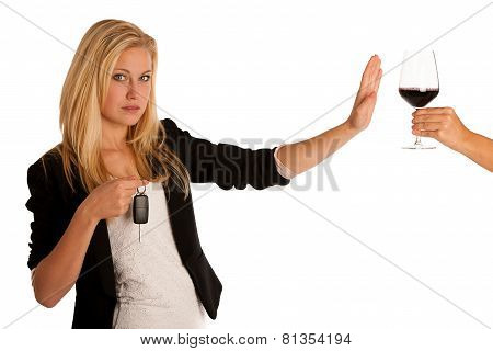 Beautiful Blond Woman Gesturing Don't Drink And Drive Gesture, With Refusing A Glass Of Red Wine Iso