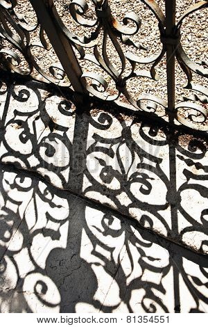 Wrought Iron Door To The Garden With Beautiful Shadow Near Villa Valmarana In Vicenca