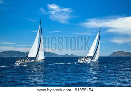 HYDRA, GREECE - CIRCA OCT, 2014: Unidentified sailboats participate in sailing regatta 12th Ellada Autumn 2014 among Greek island group in the Aegean Sea, in Cyclades and Argo-Saronic Gulf.