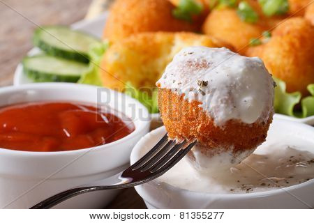 Potato Croquettes With Sour Cream Close-up In Rustic Style