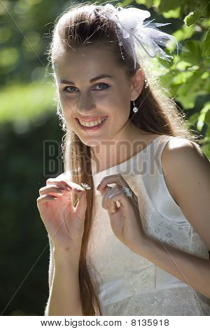 Smiling Bride With Daisy Plant