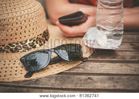 Hat And Sunglasses On Table
