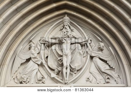 The Holy Trinity. Gothic relief in Saint Wenceslas Cathedral in Olomouc, Czech Republic.