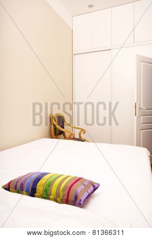 White Bedroom With Colored Pillow
