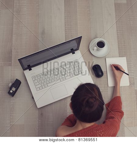 Top View Of Sketching on notepad Woman