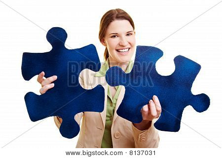 Woman With Two Fitting Jigsaw Pieces