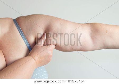 Model measuring her body