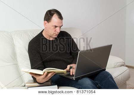 man studying from home