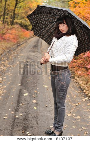 The Girl In An Autumn Wood With A Umbrella.