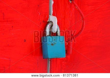 Padlock on metal door in red