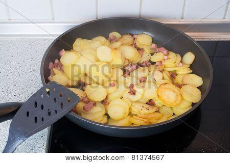 Steak and fried potatoes roast