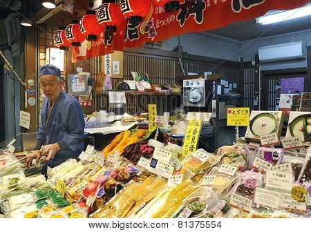 Fish Vendor At Food Market Stall In Nishiki Market In Kyoto.