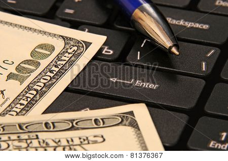 Business - Still Life of dollars, pen and computer