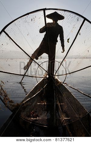 In the boat of Inle Lake fisherman