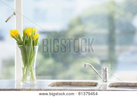 Yellow flower in a vase on the sink at home in the living room
