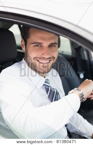 Young businessman in the drivers seat in his car