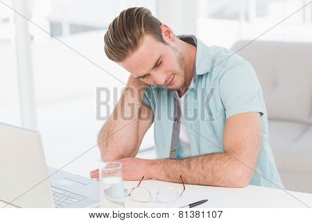 Concentrated casual businessman thinking in the office