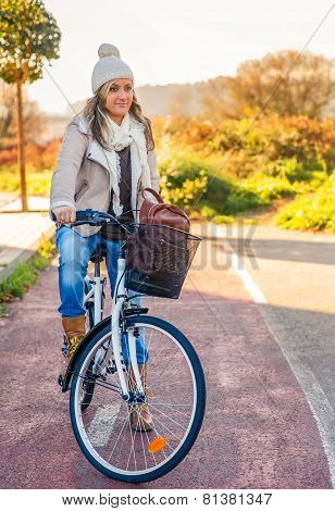 Young woman sit over bicycle in street bike lane