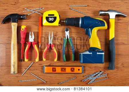 Construction Tools On The Wooden Floor