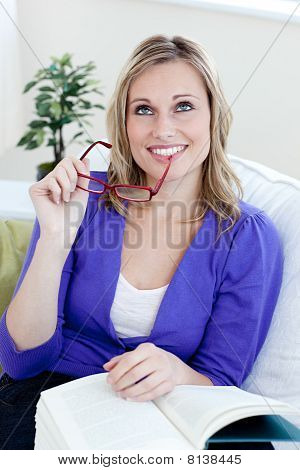 Handsome Woman Holding Glasses