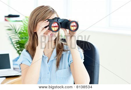 Young Businesswoman Holding Spyglass