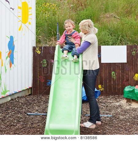 Caucasian Girl And Her Mother Having Fun With A Chute