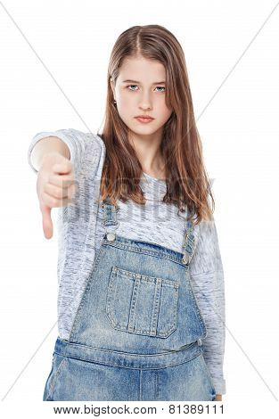 Young Teenage Girl With Thumb Down Gesture Isolated