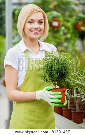 Woman Enjoying Her Work With Plants